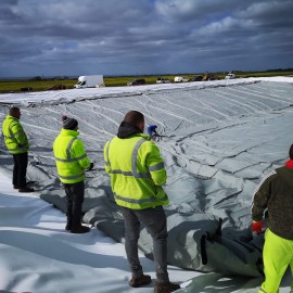 Team work for installtion of a Slurry Bag